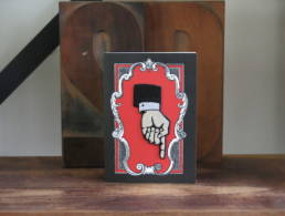 Una carte postale bazartherapy avec un cadeau a offrir